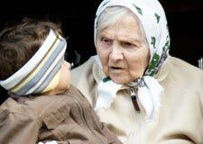 Great-grandmother. Great-grandmother and great-grandchild outdoors Stock Photos
