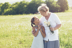 Great-grandmother and granddaughter Stock Photo