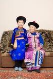 Great grandmother and grandson. Buryat (mongolian) great grandmother and grandson, in national costumes Stock Images