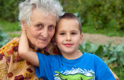 Great grandmother with her great grandchild. Together in the garden stock images