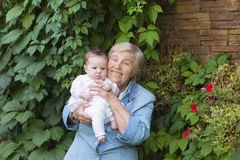 Great-grandmother holding a newborn baby Royalty Free Stock Image