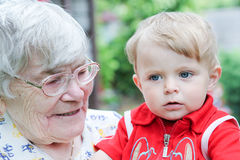 Great-grandmother with little baby boy Stock Photo