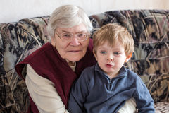 Great-grandmother with little boy Stock Photos