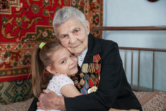 Great-grandmother - a veteran of World War II, and her great-granddaughter. Of a color photo Stock Image