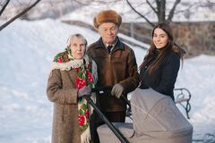 Great Grandparents walking with their granddaughter and great granddaughter stock photography