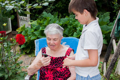 Great-grandson of the great-grandmother teaches contact Stock Image