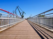 Great, green shipbuilding cranes. Historical cranes in the shipyard in Gdansk - Poland Stock Images