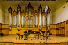 The Great Hall of the conservatory named after Petr Tchaikovsky. Scene with musical instruments. MOSCOW, Russia-December 30, 2017: The Great Hall of the Stock Images