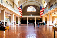Great Hall inside the processing center on Ellis Island. Great Hall at Ellis Island, where it all began for millions of immigrants who came to America to live in Royalty Free Stock Photo