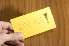 Great handwrite on a yellow paper with a pen on a table. Composition royalty free stock image