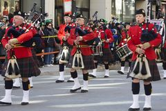 Great Highland Bagpipe players in traditional Scottish uniform at Montreal Saint Patrick`s Day Parade stock photography