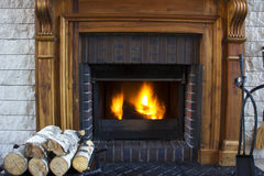 Great Home Fire burning in the fireplace. Seasonal and holiday fire Stock Photos