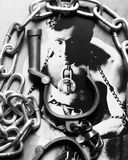 Great Houdini photo with handcuffs and chains on top. High security handcuffs as used by the police in UK with chain and Harry Houdini photo Royalty Free Stock Image