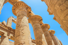 Great Hypostyle Hall and clouds at the Temples of Karnak (ancient Thebes). Luxor, Egypt royalty free stock photos