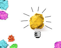 Great idea. Crumpled paper with idea light bulb concept and colorful crumpled papers around Stock Image