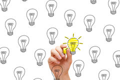 Great Idea. So many ideas, but only a few are great. One glowing light bulb among many Stock Photos