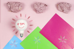 Great idea concept with crumpled colorful paper and light bulb on light background. Creative brainstorm concept business idea Royalty Free Stock Photo