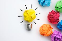 Great idea concept with crumpled colorful paper and light bulb stock photography