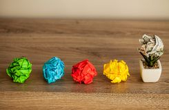 Great idea concept. Crumpled colorful paper on wooden table stock photo