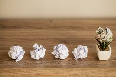 Great idea concept. Crumpled colorful paper on wooden table royalty free stock photography