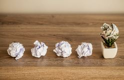 Great idea concept. Crumpled colorful paper on wooden table royalty free stock images
