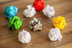 Great idea concept. Crumpled colorful paper on wooden table royalty free stock image