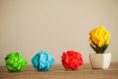 Great idea concept. Crumpled colorful paper on wooden table. Copy space royalty free stock photography
