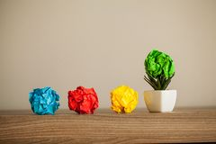 Great idea concept. Crumpled colorful paper on wooden table. Copy space stock photos