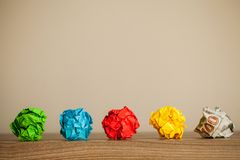 Great idea concept. Crumpled colorful paper on wooden table. Copy space stock image