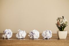 Great idea concept. Crumpled colorful paper on wooden table. Copy space royalty free stock photo