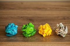 Great idea concept. Crumpled colorful paper on wooden table. Copy space stock photo