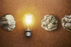 Great idea concept with crumpled paper and light bulb on wooden Royalty Free Stock Photo