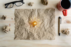 Great idea concept with crumpled paper and light bulb on wooden Stock Images