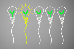 Great Idea and Innovation concept, with green plant in light bulbs on gradient in gray background. stock illustration