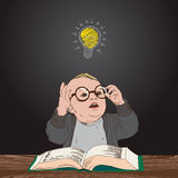 Great idea, kid with book and bulb above his head Royalty Free Stock Images