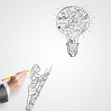 Great idea for success. Female hand drawing with pencil business idea concept on white background stock images