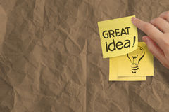 Great idea words crumpled sticky note paper on texture paper Royalty Free Stock Image