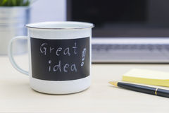 Great idea words on mug with computer, pen and notes Stock Photos