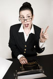 Great Ideas. Retro business woman with vintage typewriter stock photography