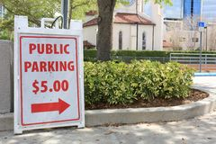 Public Parking Sign for $5.00 in City Parking Lot royalty free stock photo