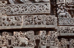 Great Indian architecture, with fantasy animals, birds, ancient people and patterns inside 12th century temple, India. Stock Photos