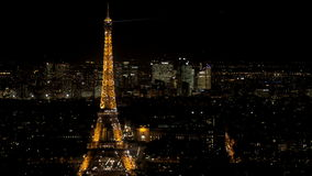 Great introduction shot for Paris. Arc de Triomphe panning to Eiffel tower at night. Aerial perspective stock footage