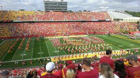 The Great Iowa State. This photo shows the great Iowa State Football Stadium. All sorts of people watching the band play royalty free stock photography