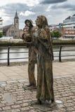 Great Irish Famine statue in Dublin, Ireland. Dublin, Ireland - August 7, 2017: Great Irish Famine bronze statue set on Custom House Quay along Liffey River in Stock Images