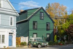 Great Island Inn in New Castle in NH, USA. Historic Great Island Inn and antique Ford Bronco Wagon first generation near town hall on Main Street in New Castle royalty free stock photo