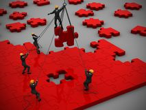 Jigsaw puzzle in Red being built by teamwork as 3d rendering. A great jigsaw puzzle in red being built by a successful team as 3d rendering Stock Images