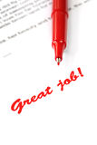 Great Job. A red pen with the words great job on a white printed page Royalty Free Stock Images