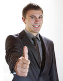 Great job. Businessman showing thumb up and smiling stock photos