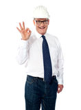Great job done!. Mature builder showing approval gesture isolated over white Royalty Free Stock Photos