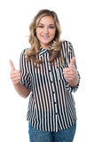 Great job. Keep it up!. Attractive woman showing double thumbs up Stock Images